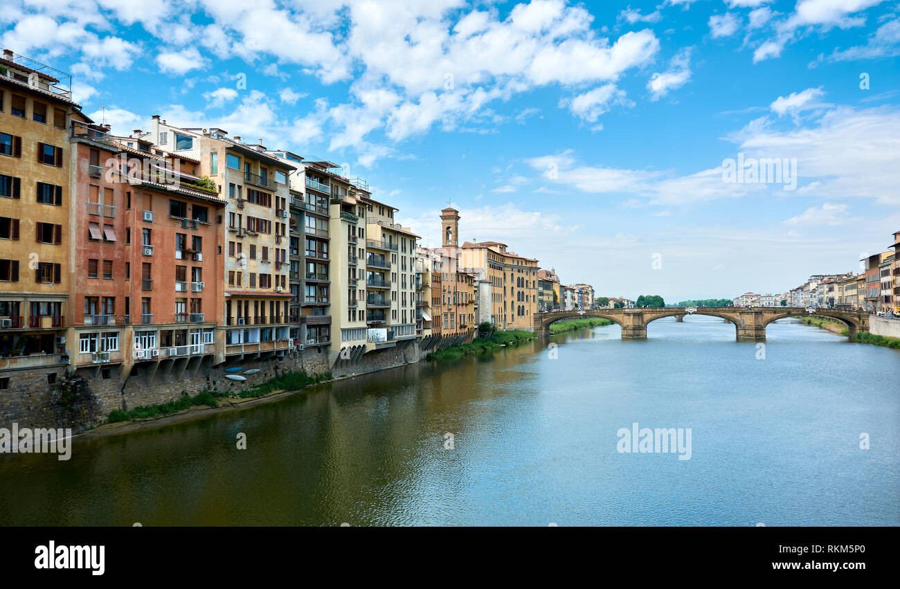 Cityscape with picturesque buildings surrounding the Arno River and the Saint Trinity Bridge (Ponte Santa Trinita) on a beautiful sunny spring day in  - Stock Image
