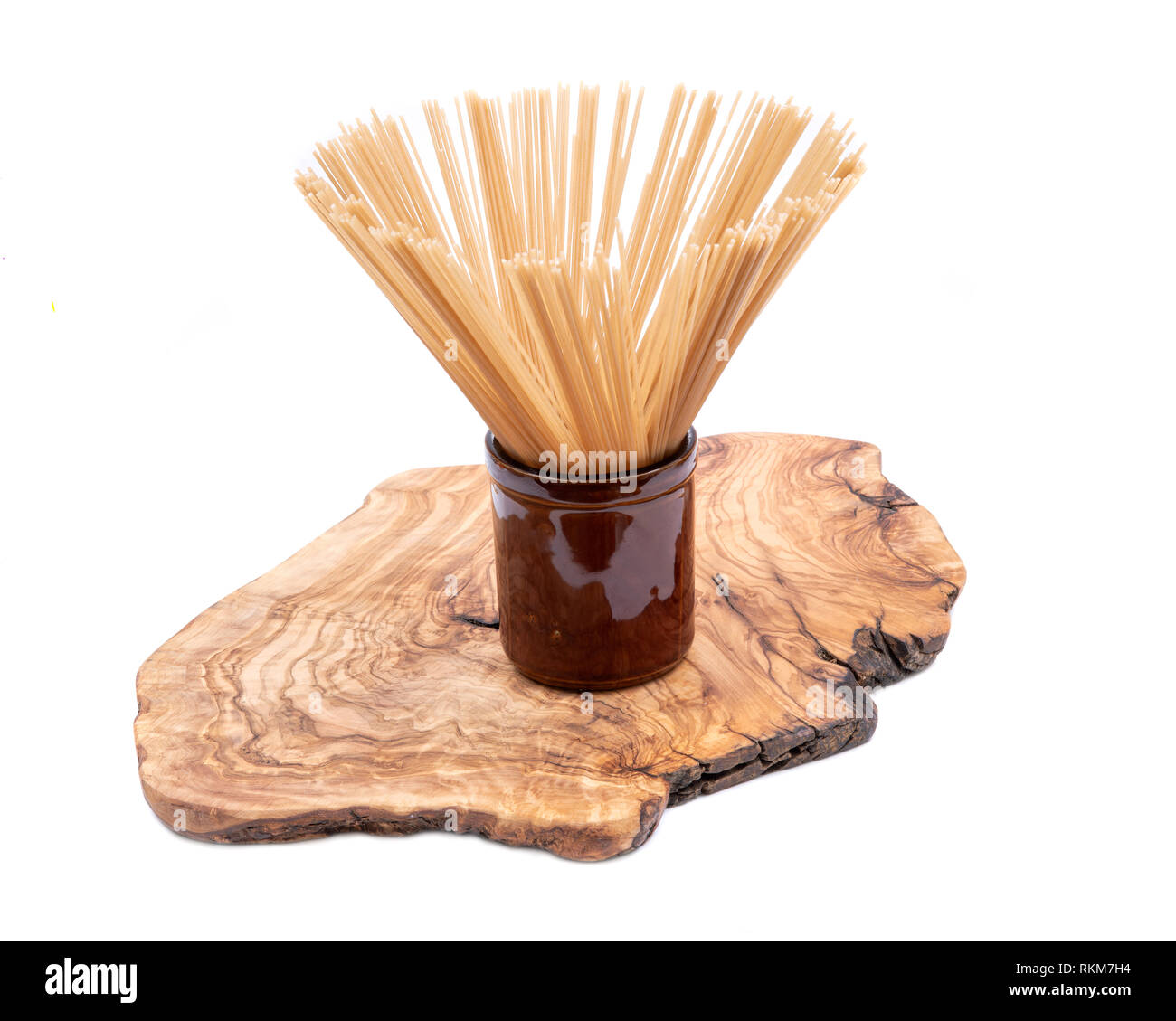 Organic uncooked Brown Rice Spaghetti pasta arranged in a tall round
