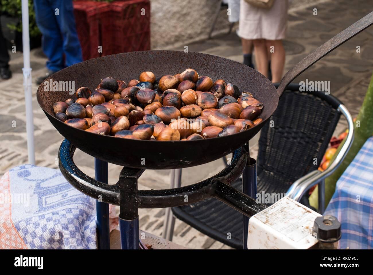 Roasting chestnuts. Pampaneira, Alpujarras, Spain. - Stock Image
