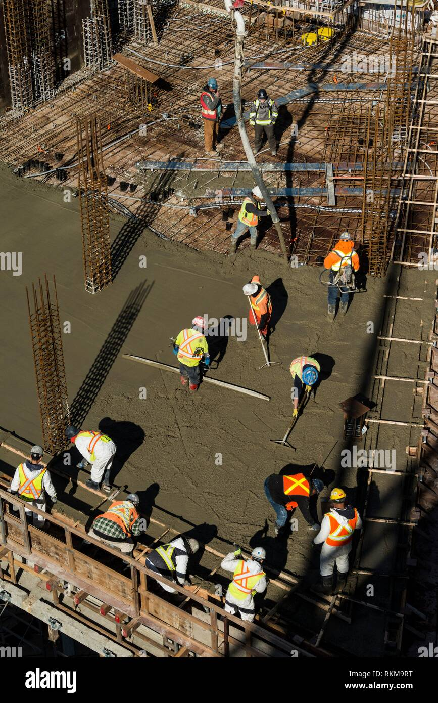Construction workers at Vancouver House, a tower under construction in Vancouver, BC, Canada. Stock Photo