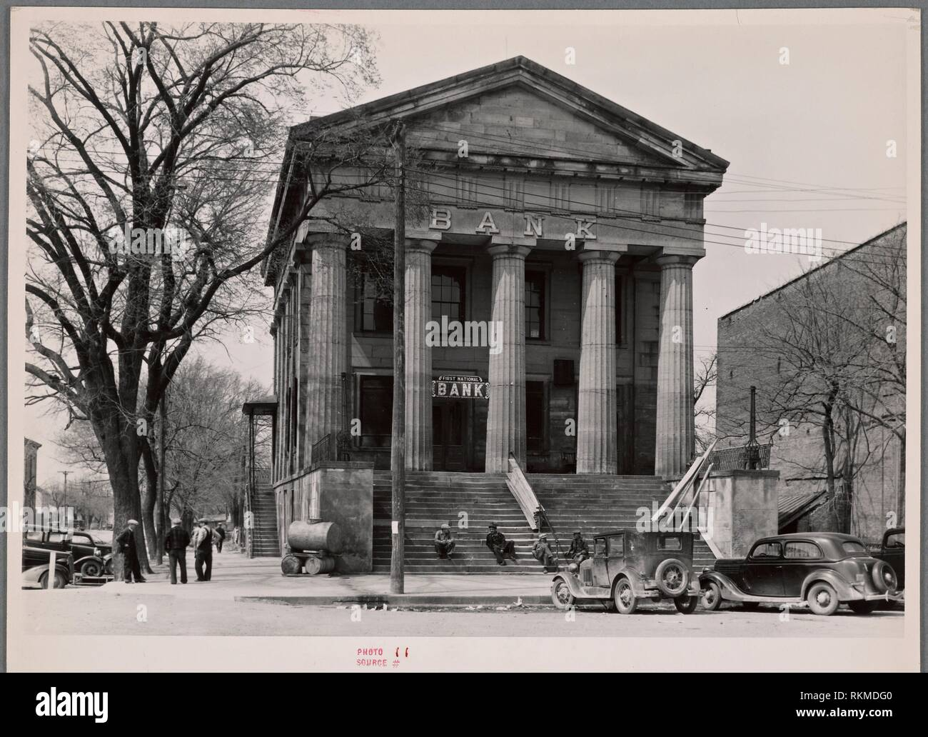 Bank in Shawneetown, Illinois, built by state in 1839. Note water tank (for drinking water purposes) on sidewalk, left. United States. Farm Security - Stock Image