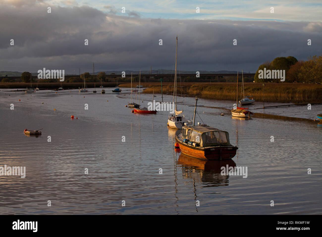 Boats and reedbeds near Topsham Exe Estuary Devon England UK - Stock Image