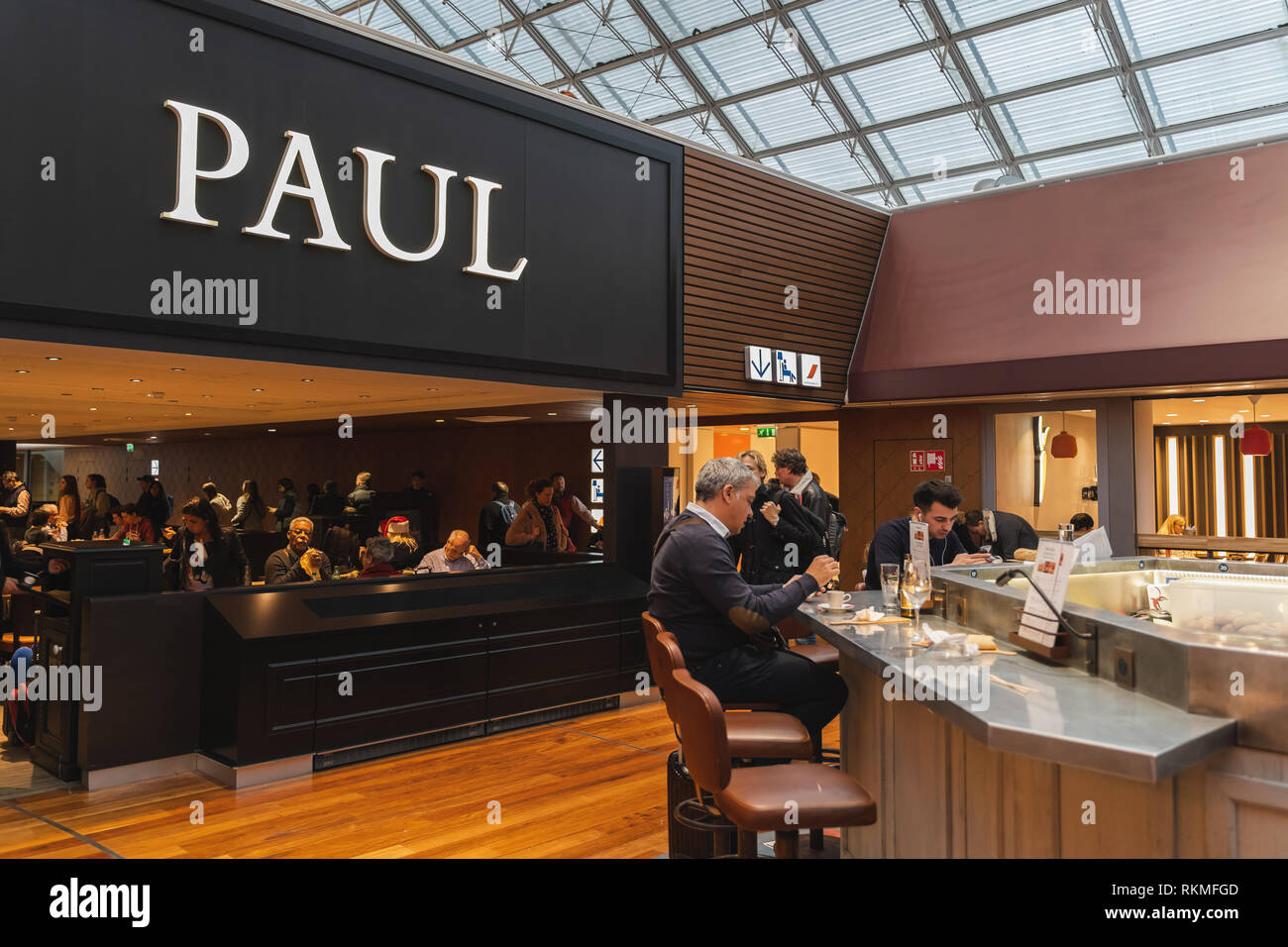 CDG Airport, Paris - 12/22/18: Paul logo above food court area in Paris airport. Logo of famous French bakery and restaurant. - Stock Image