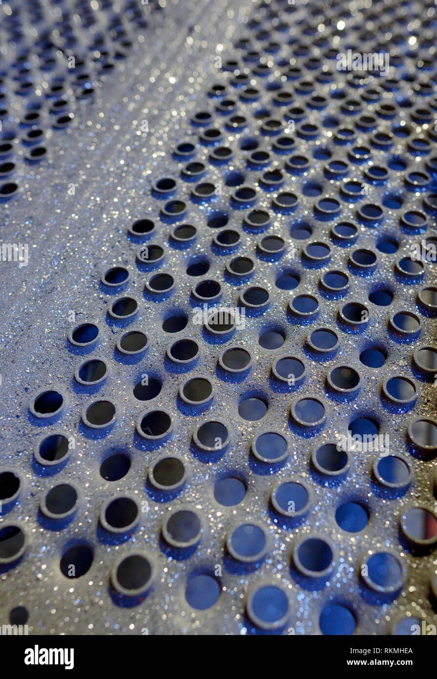 Details of perforated industrial steel background. - Stock Image