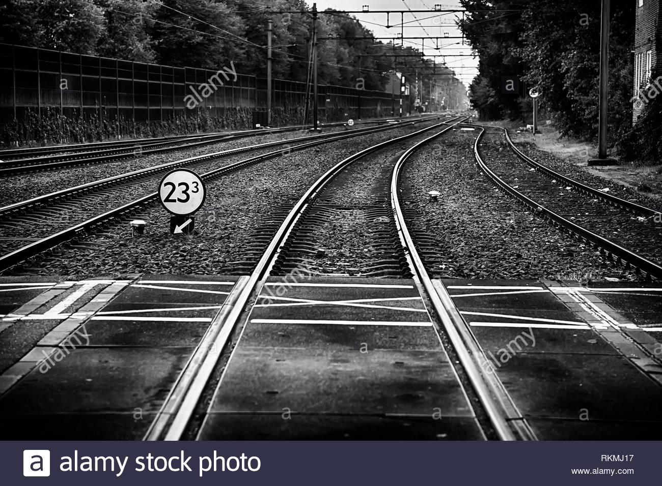 Train tracks in a station, transport detail by rails, trip. - Stock Image
