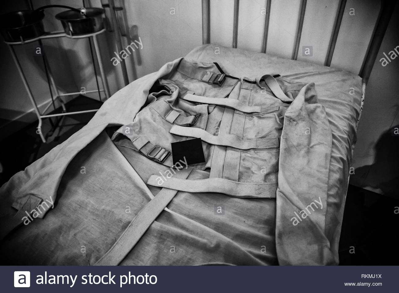 Old psychiatric straitjacket, mental hospital detail, psychosis. - Stock Image