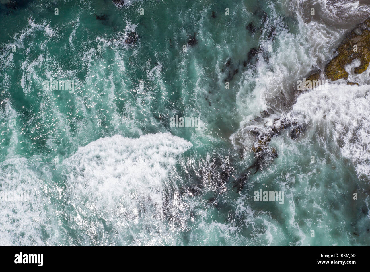 Waves approaching the coast at Las Brisas beach turquoise waters creating impressive forms in order to get to the coastline and crash the sand - Stock Image