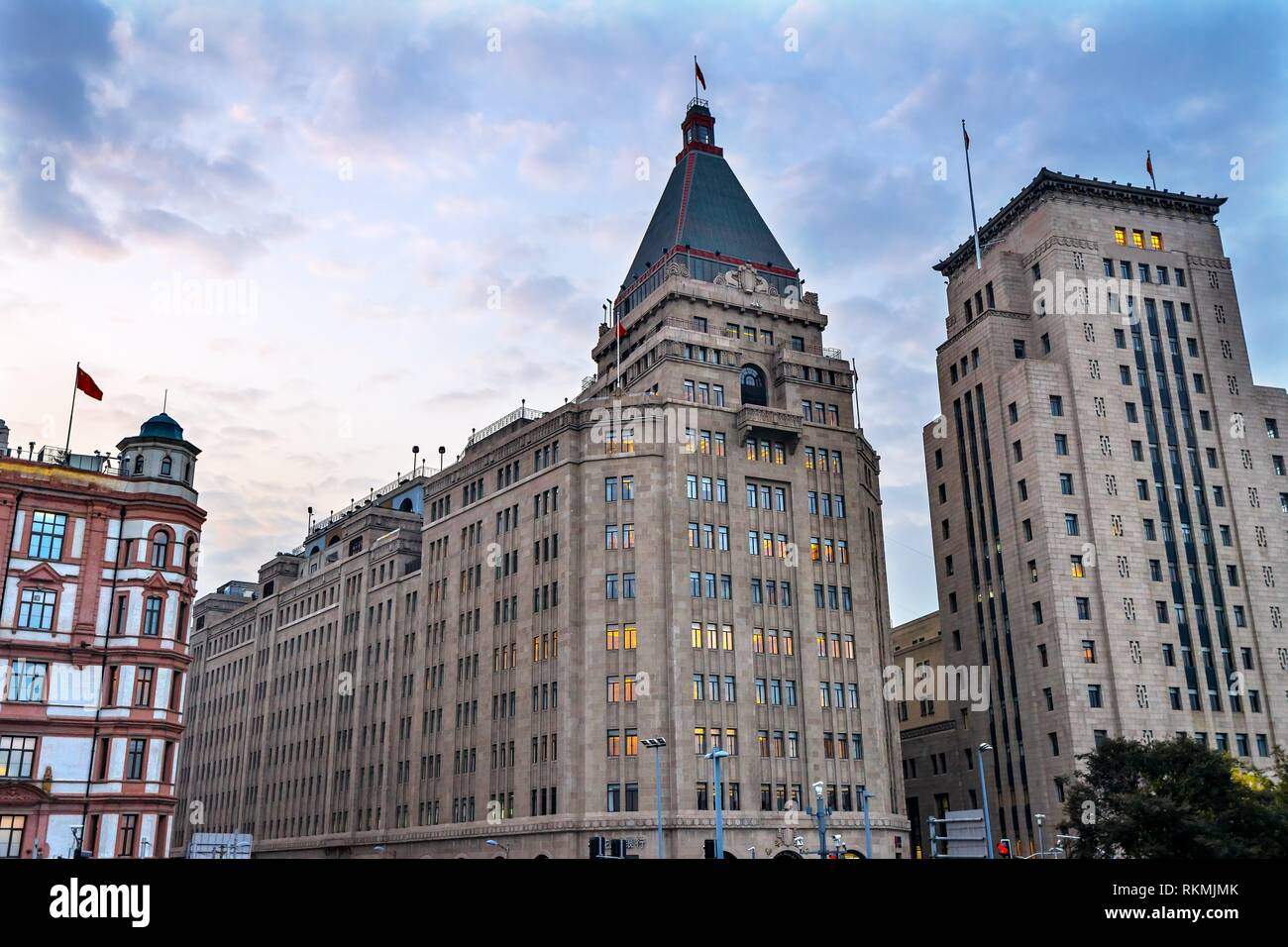 Peace Hotel Bund Buildings Evening Shanghai China One of the most famous places in Shanghai and China. Oldest Hotel in Shanghai, was famous hotel in - Stock Image