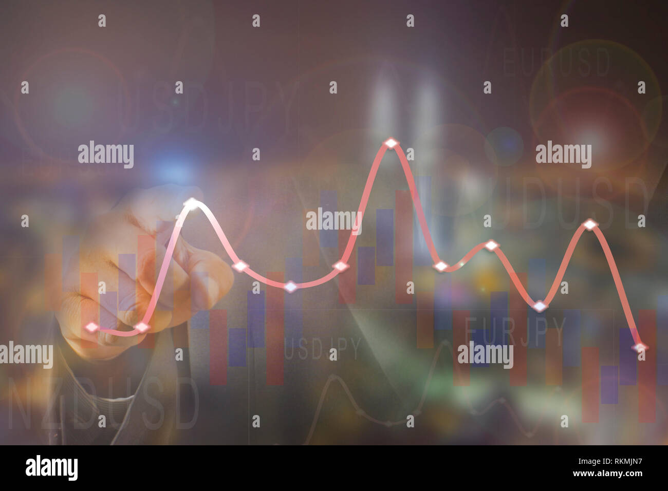 Hand pointing on a forex chart over blurred background image. - Stock Image