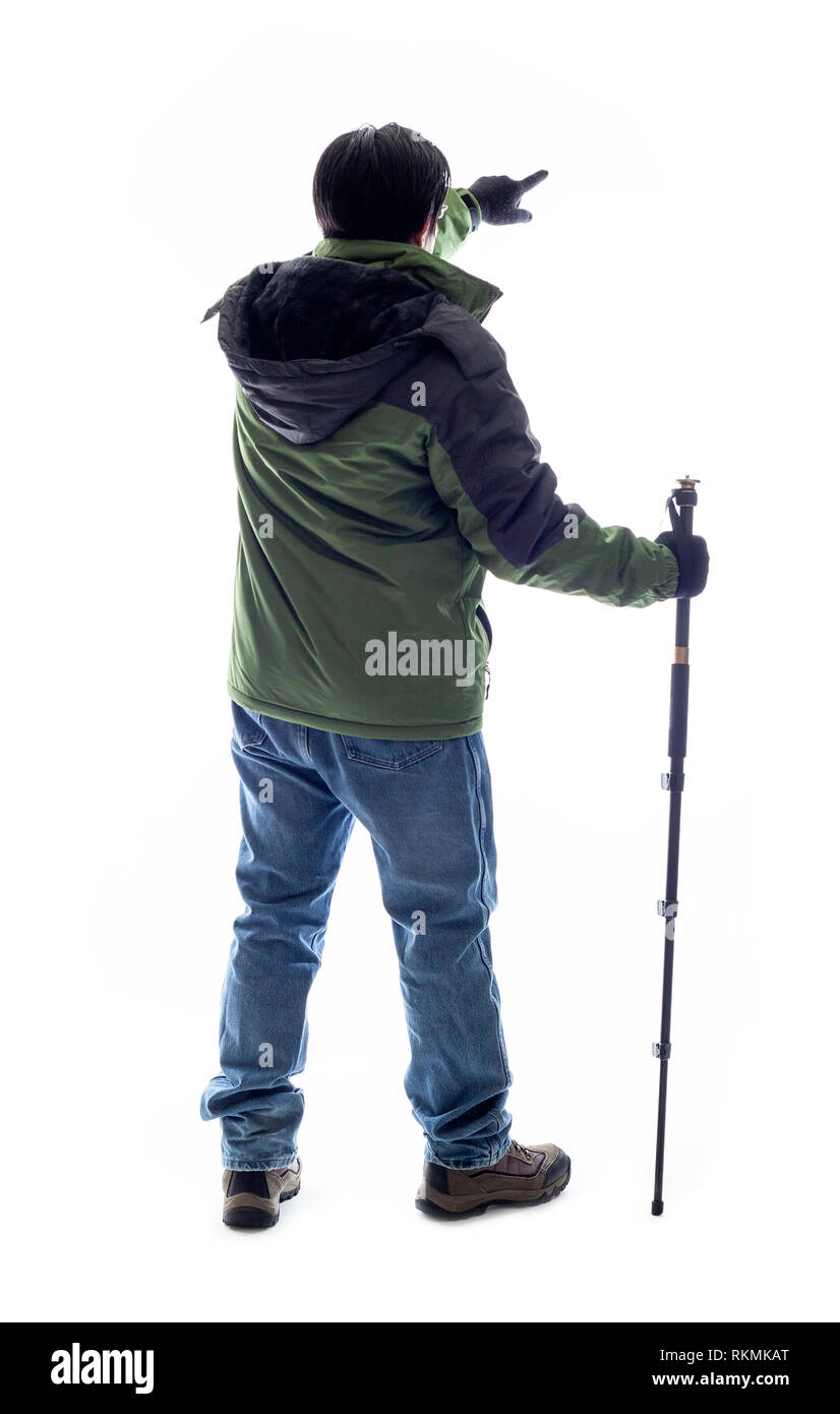 Mountain Climber or Hiker looking at a white background for composite.  The man is isolated and acting like he is looking at a view to depict outdoor  - Stock Image