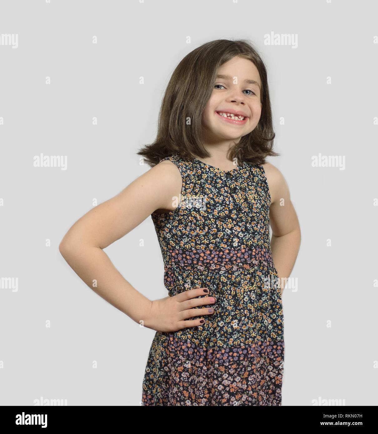 Headshot of smiling little girl with short bob hair cut