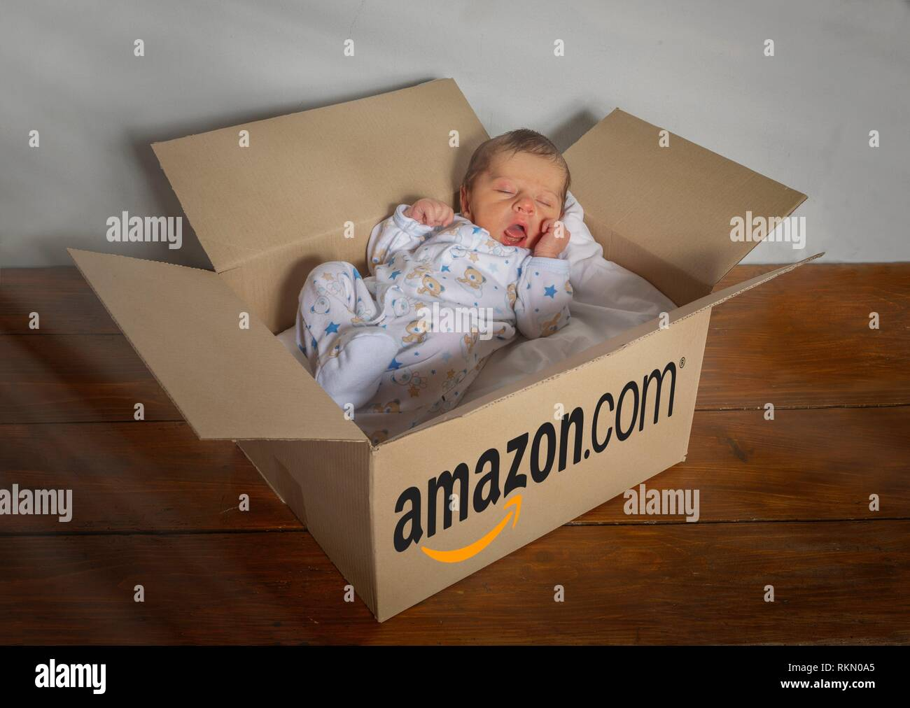 newborn baby delivered by amazon - Stock Image