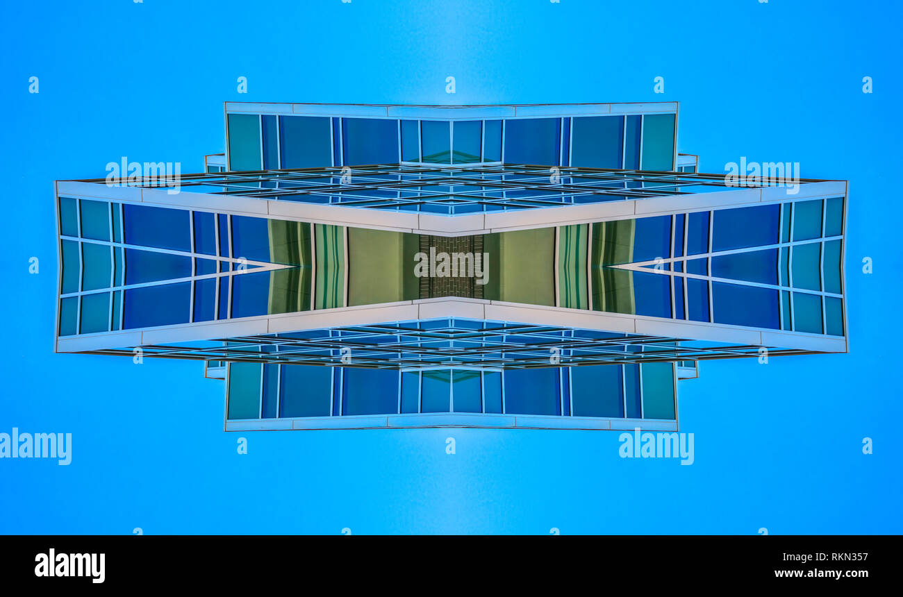 Abstract angular building in Provo Utah grid. Geometric kaleidoscope pattern on mirrored axis of symmetry reflection. Colorful shapes as a wallpaper f Stock Photo
