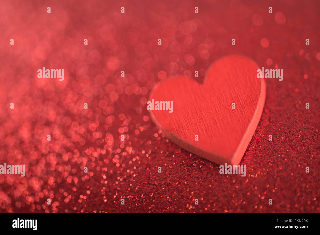 Red heart on glitter background in love concept Stock Photo