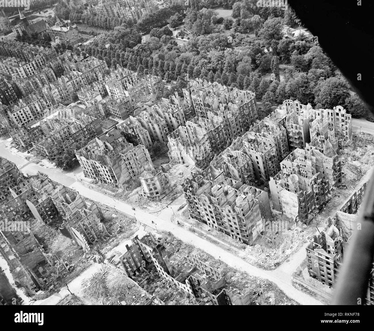 Oblique aerial view of ruined residential and commercial buildings south of the Eilbektal Park (seen at upper right) in the Eilbek district of Hamburg, Germany. These were among the 16,000 multi-storeyed apartment buildings destroyed by the firestorm which developed during the raid by Bomber Command on the night of 27/28 July 1943 (Operation GOMORRAH). The road running diagonally from upper left to lower right is Eilbeker Weg, crossed by Rückertstraße. - Stock Image