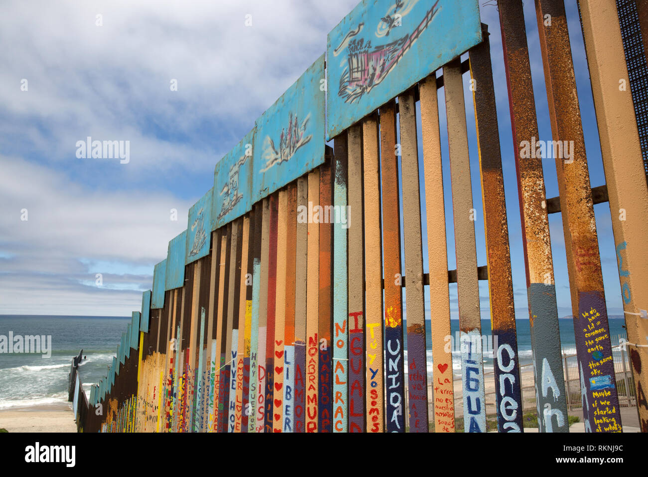 View from the Mexican side of Mexico-United States border fence where it meets the Pacific Ocean in Tijuana, Mexico on June 9, 2017. Photo by Bénédict - Stock Image