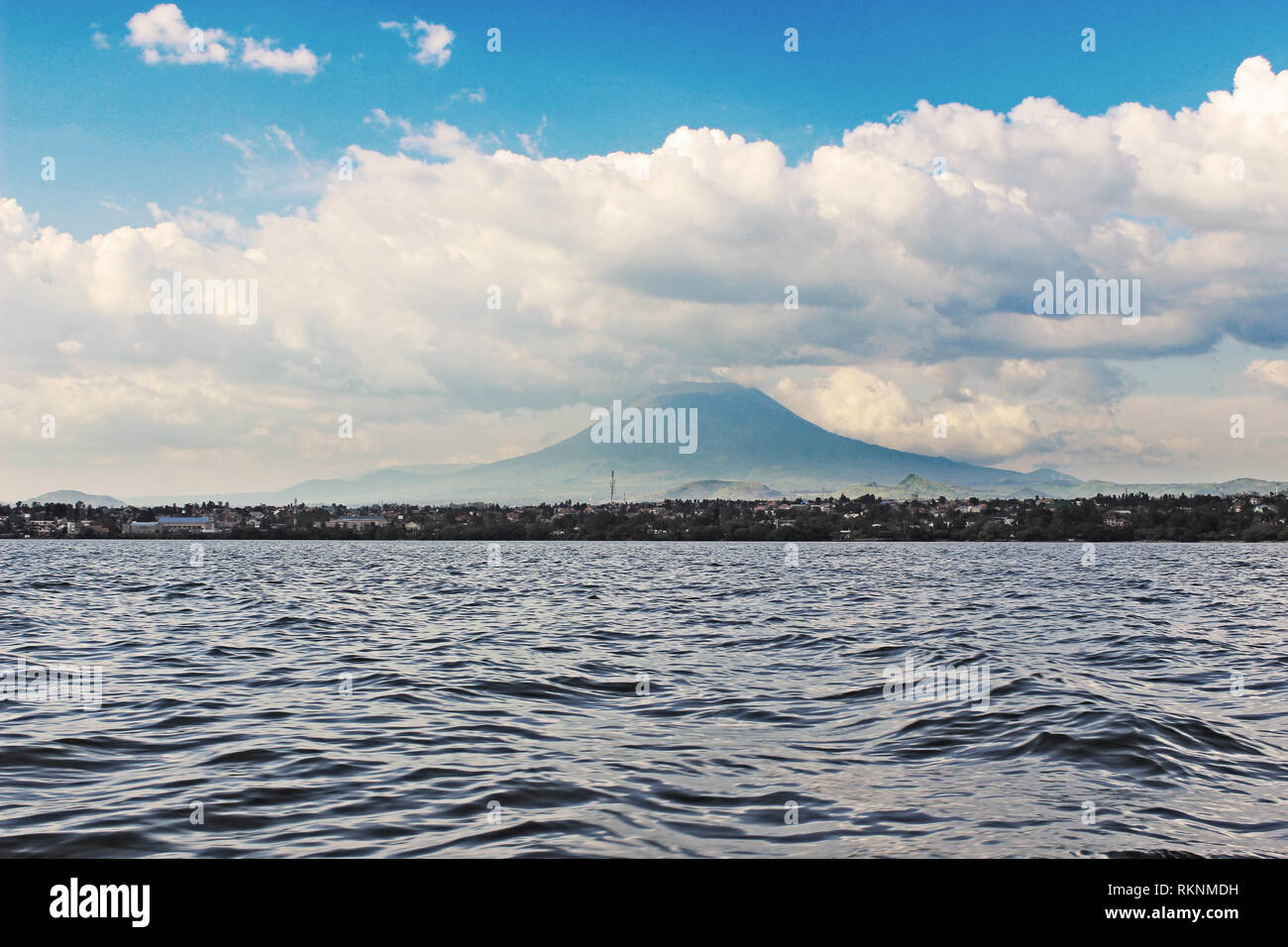 Lake Kivu, Rwanda, with Mount Nyiragongo of DR Congo in the Background. Nice Weather for a Boat Ride. Stock Photo