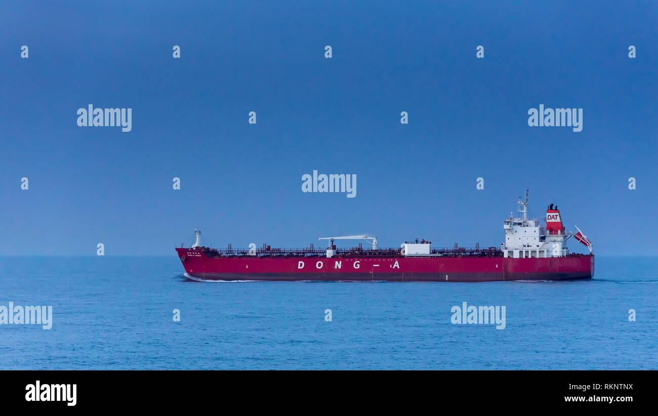 A cargo ship in the South China Sea near Japan. - Stock Image