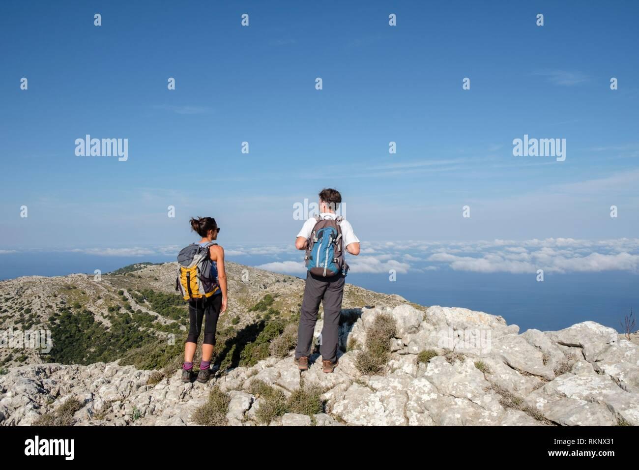 Hikers in Puig des Teix, Valldemossa, Mallorca, Balearic islands, Spain. - Stock Image