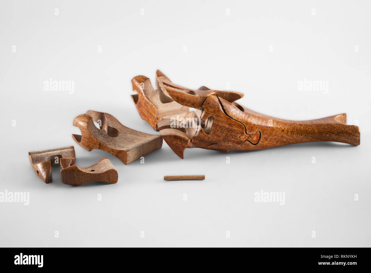 wooden creative dolphin puzzle toy on white - Stock Image