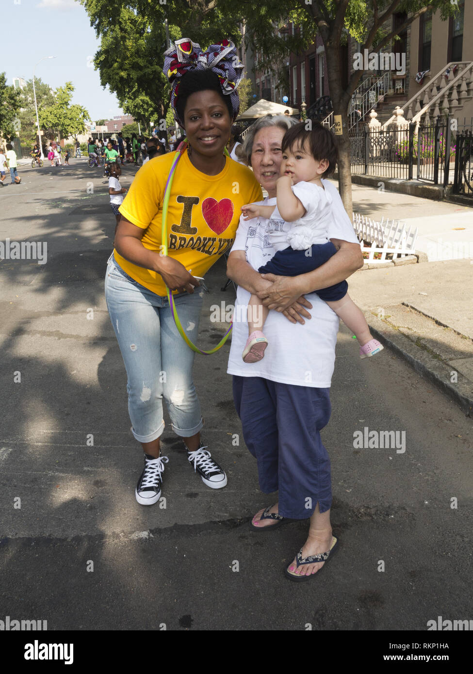 Neighbors at block party in the Bedford-Stuyvesant section of Brooklyn, NY. - Stock Image