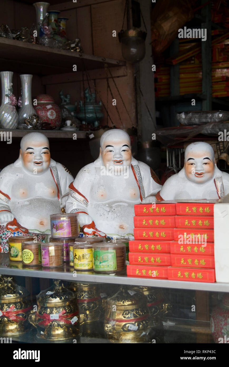 Laughing Buddha for sale in a shop in Malacca, also known as Melaka, Malaysia. - Stock Image