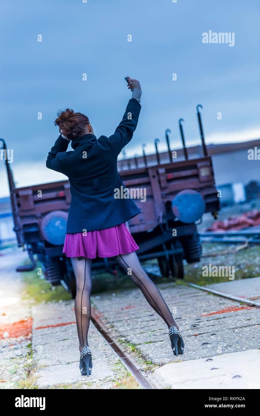 Young woman legs heels slim fit slender thin highheels alpfabet Stock Photo