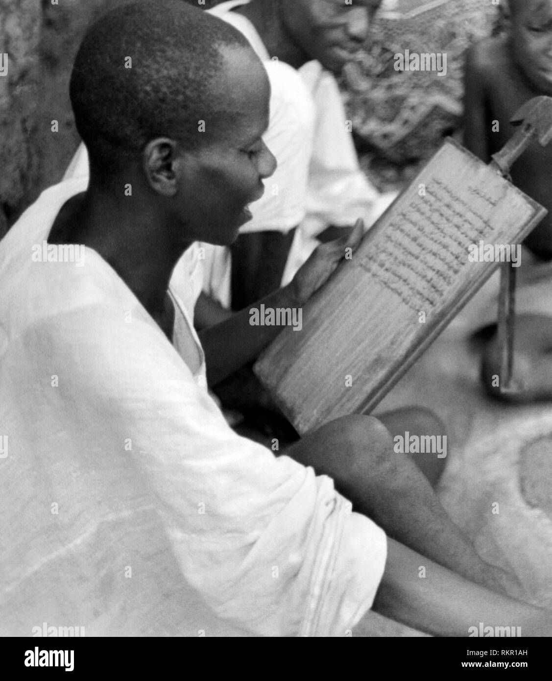 africa, ghana, young dagomba while reading the Koran, 1930 - Stock Image