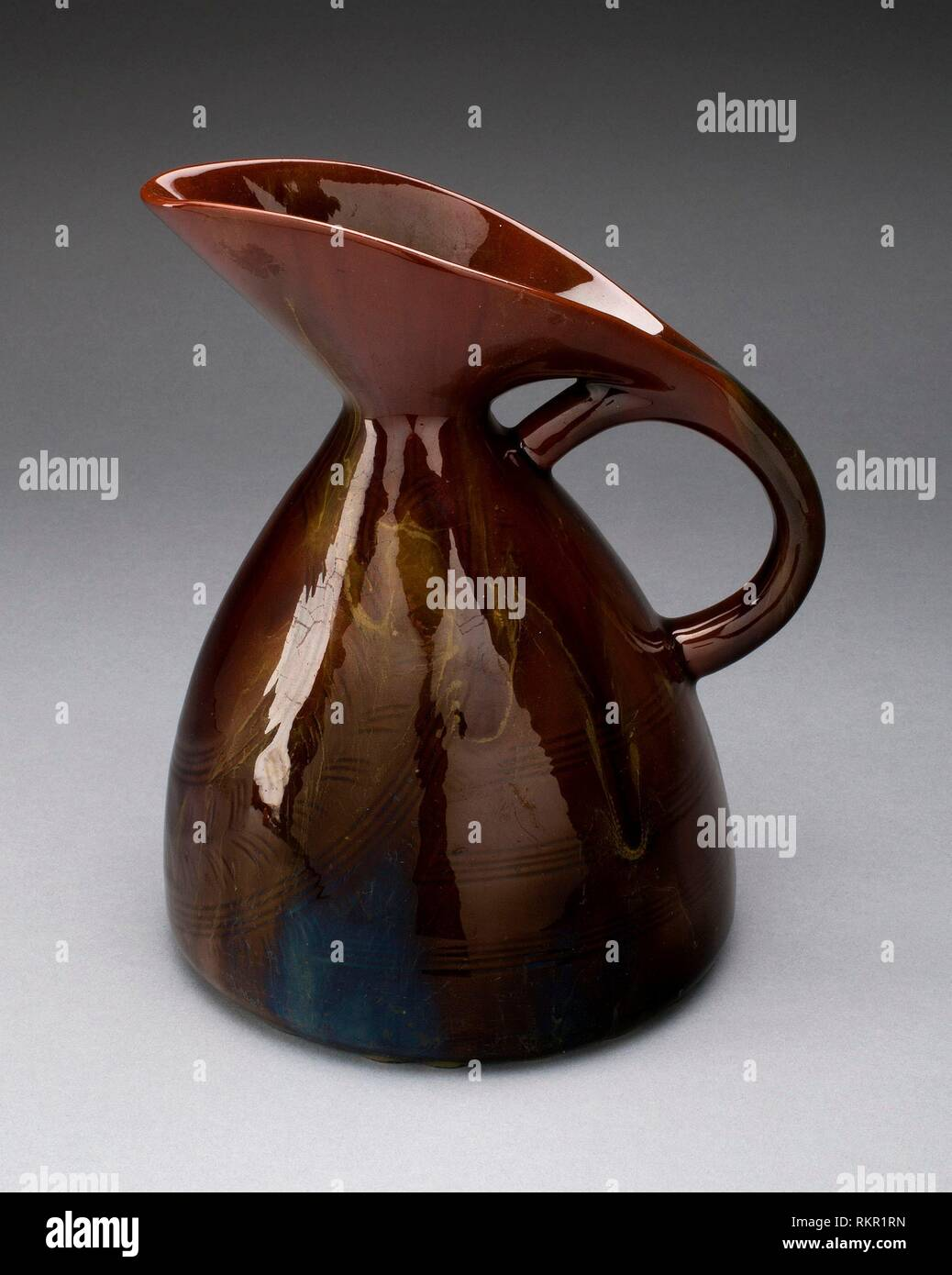 Pitcher - 1880 - Designed by Christopher Dresser, English, born Scotland, 1834-1904 Manufactured by Linthorpe Art Pottery English, Yorkshire, - Stock Image