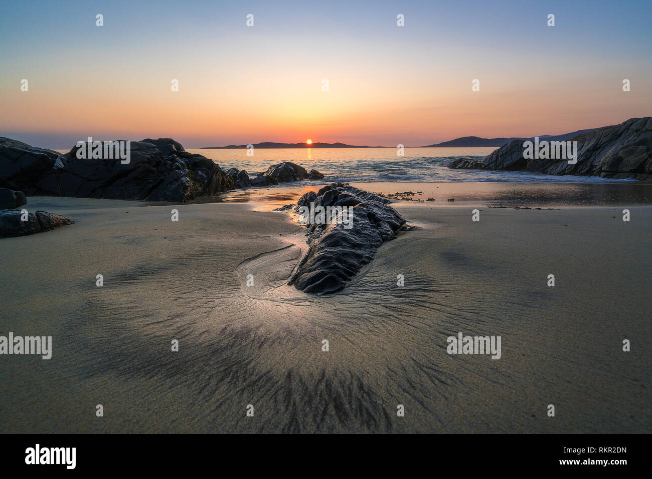 Circular sand pattern on a sunset beach on the Isle of Harris, Outer Hebrides, Scotland - Stock Image