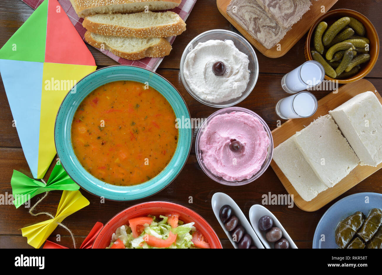 Fasting food for Clean Monday and a kite on wooden table - Stock Image