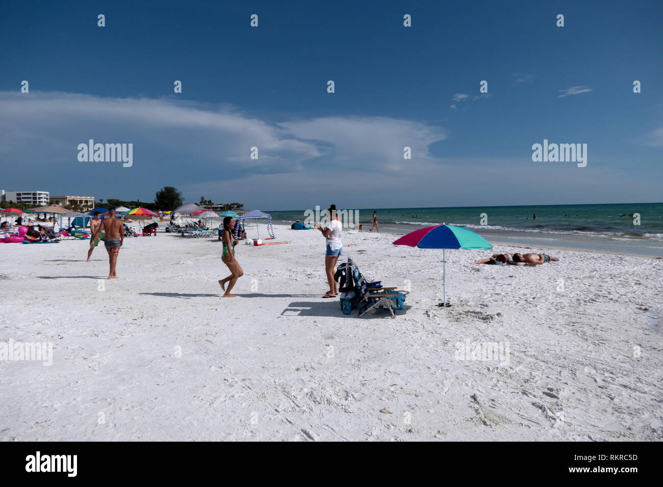 People relaxing on holiday on the Siesta Key beach in Sarasota, Florida, USA. Tourists on summer vacation near the sea. American landscape and recreat - Stock Image