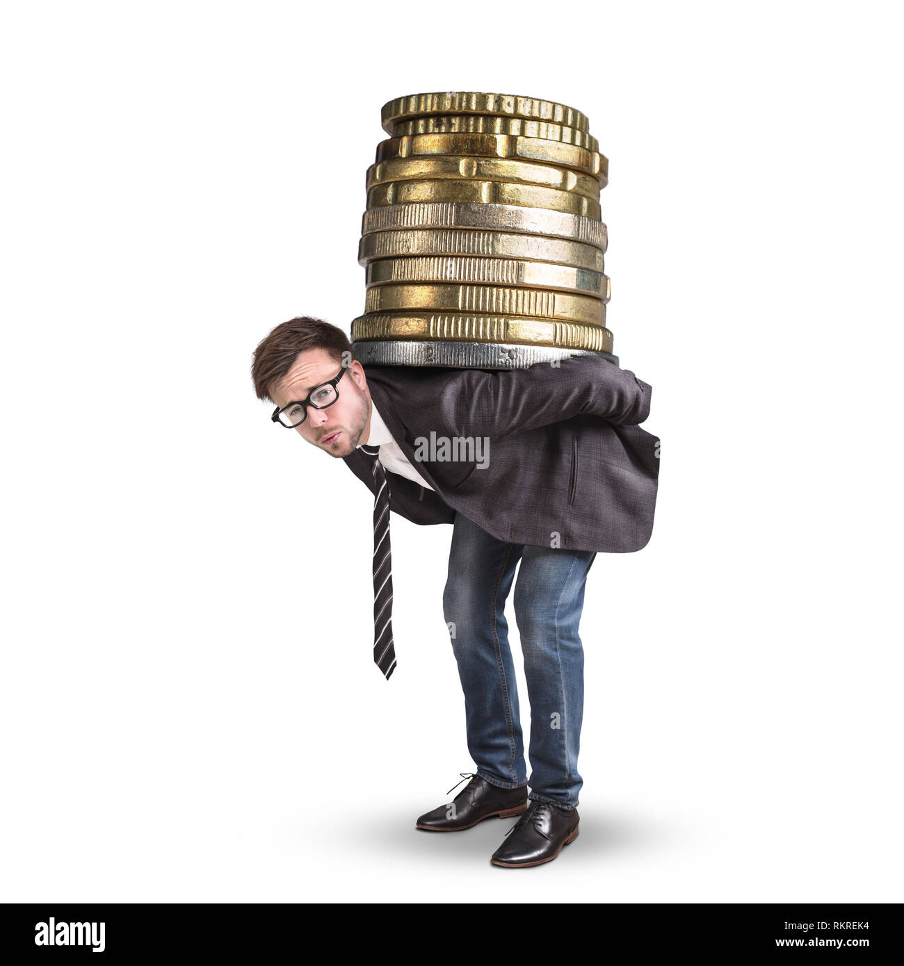 Businessman carrying a giant stack of coins on his back - Stock Image