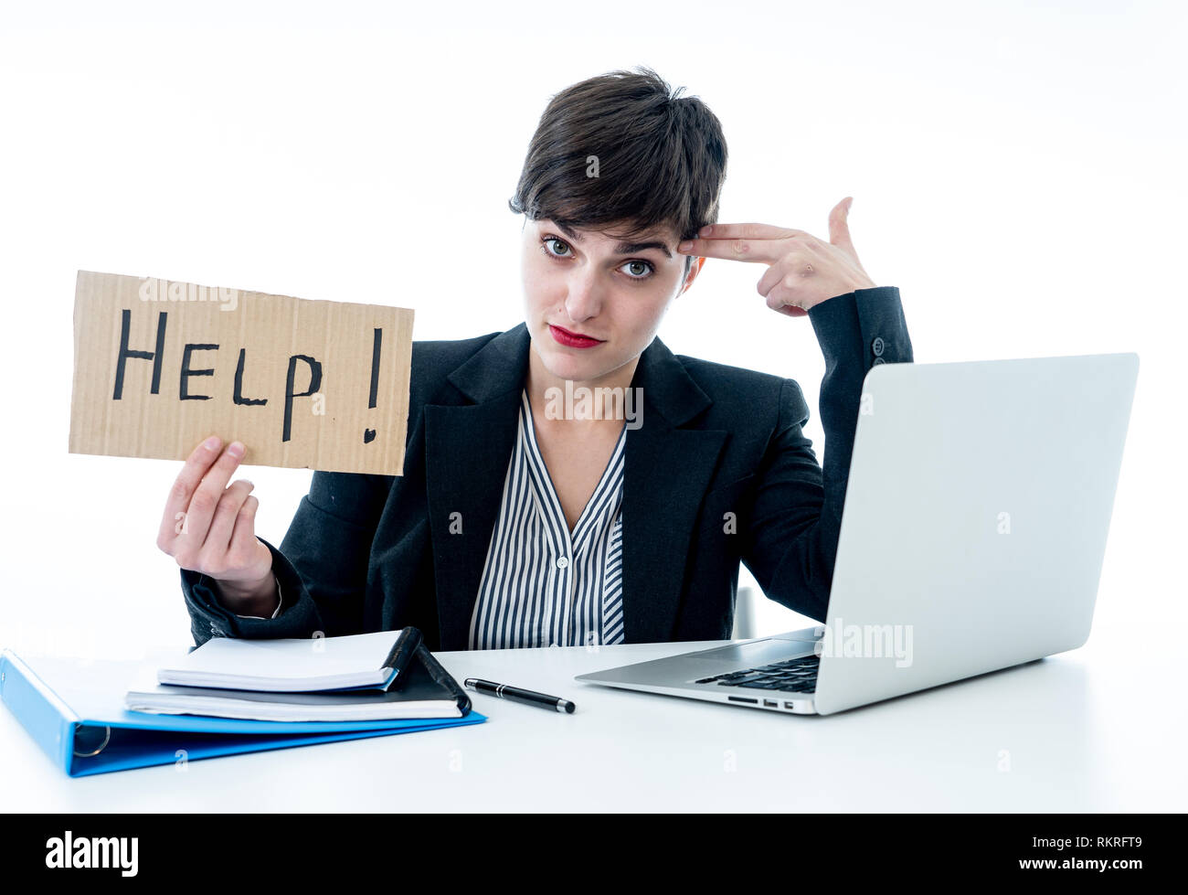 Tired and frustrated young attractive business woman working on computer holding desperate a help sign at office isolated on white background. Coping  - Stock Image