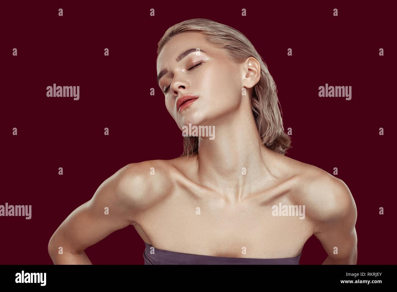 Blonde-haired model having sensitive feelings while posing - Stock Image