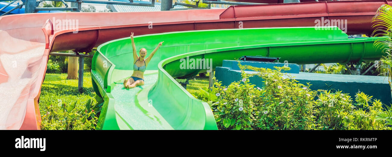 woman is having fun in the water park BANNER, long format - Stock Image