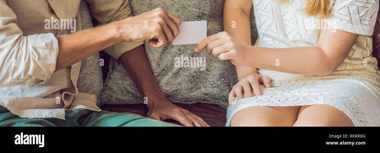 A woman gives to a man security key card or business card BANNER, long format - Stock Image