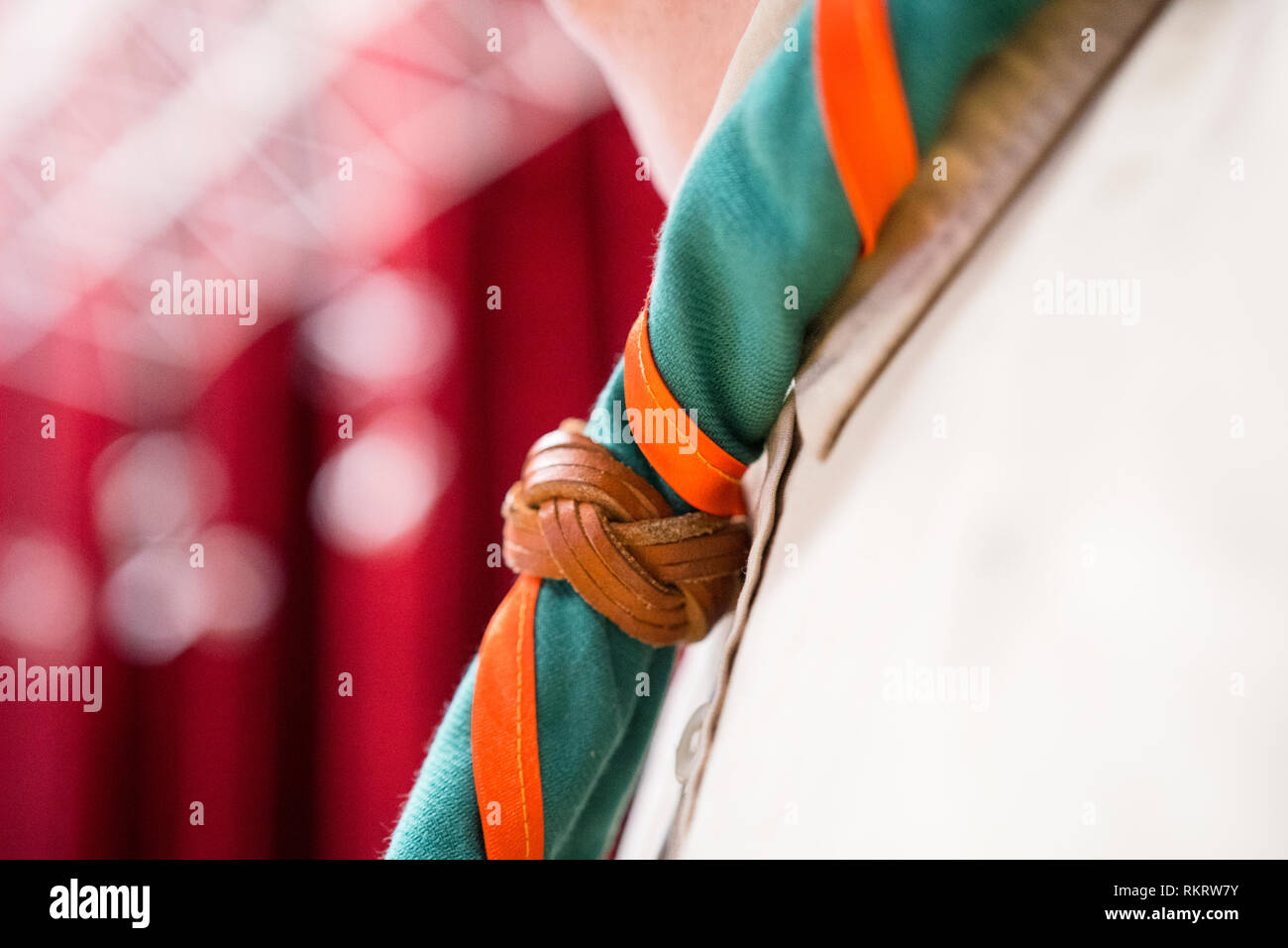 Close-up shot of chest of a scout man wearing the neck wrapped scarf - Stock Image