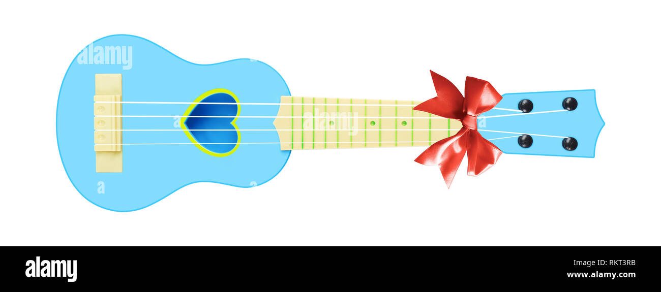 Musical instrument - Front view gift blue child baby ukulele acoustic guitar a red bow isolated on a white background. - Stock Image