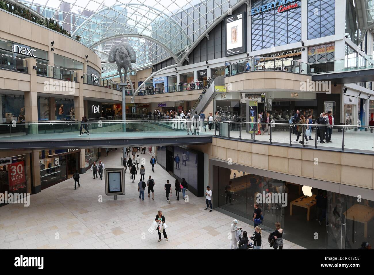 LEEDS, UK - JULY 12, 2016: People walk in Trinity Leeds shopping and leisure centre in Leeds, UK. The modern development was designed by Chapman Taylo - Stock Image