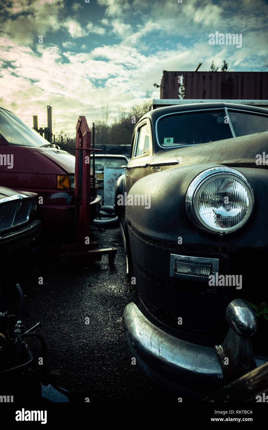 Classic American Chrysler sedan car Scottish Highlands, sitting abandoned on garage forecourt - Stock Image