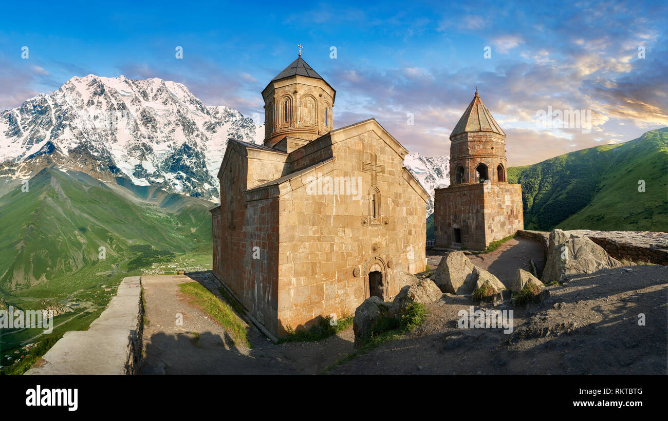 Pictures & images of Gergeti Holy Trinity (Tsminda Sameba) Georgian Orthodox and Apostolic Church and bell tower, 14th century, Gergeti, Khevi provinc - Stock Image