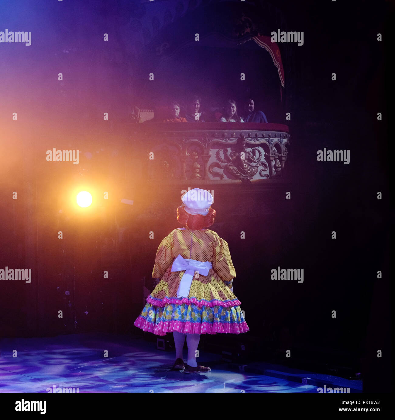 Pantomime Dame, 'May McFettridge' addresses members of the audience in a box at Belfast Grand Opera House. - Stock Image