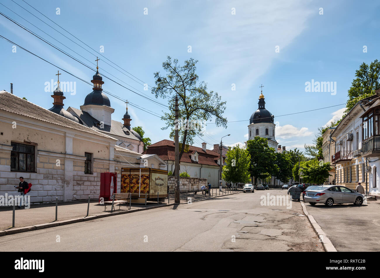 Kyiv, Ukraine - May 10, 2015: Grigory Skovoroda Street and Church of the Annunciation of the Mother of God at the Kyiv-Mohyla Academy at historic dist - Stock Image