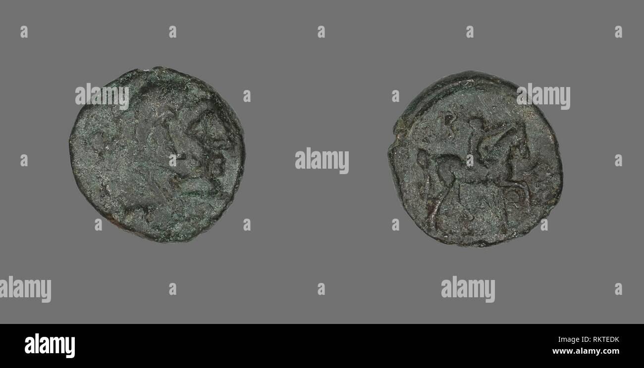 Coin Depicting the Hero Herakles - 277/239 BC - Greek - Artist: Ancient Greek, Origin: Ancient Greece, Date: 277 BC–239 BC, Medium: Bronze, - Stock Image