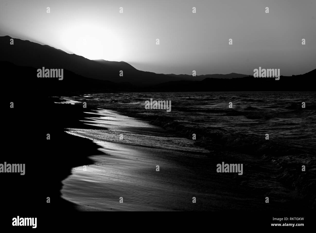 Beach at sunset - Stock Image