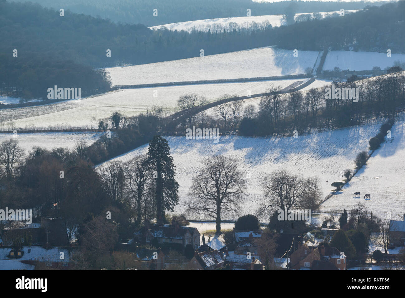 Winter view of the Chiltern village of Turville with snow on the ground. - Stock Image