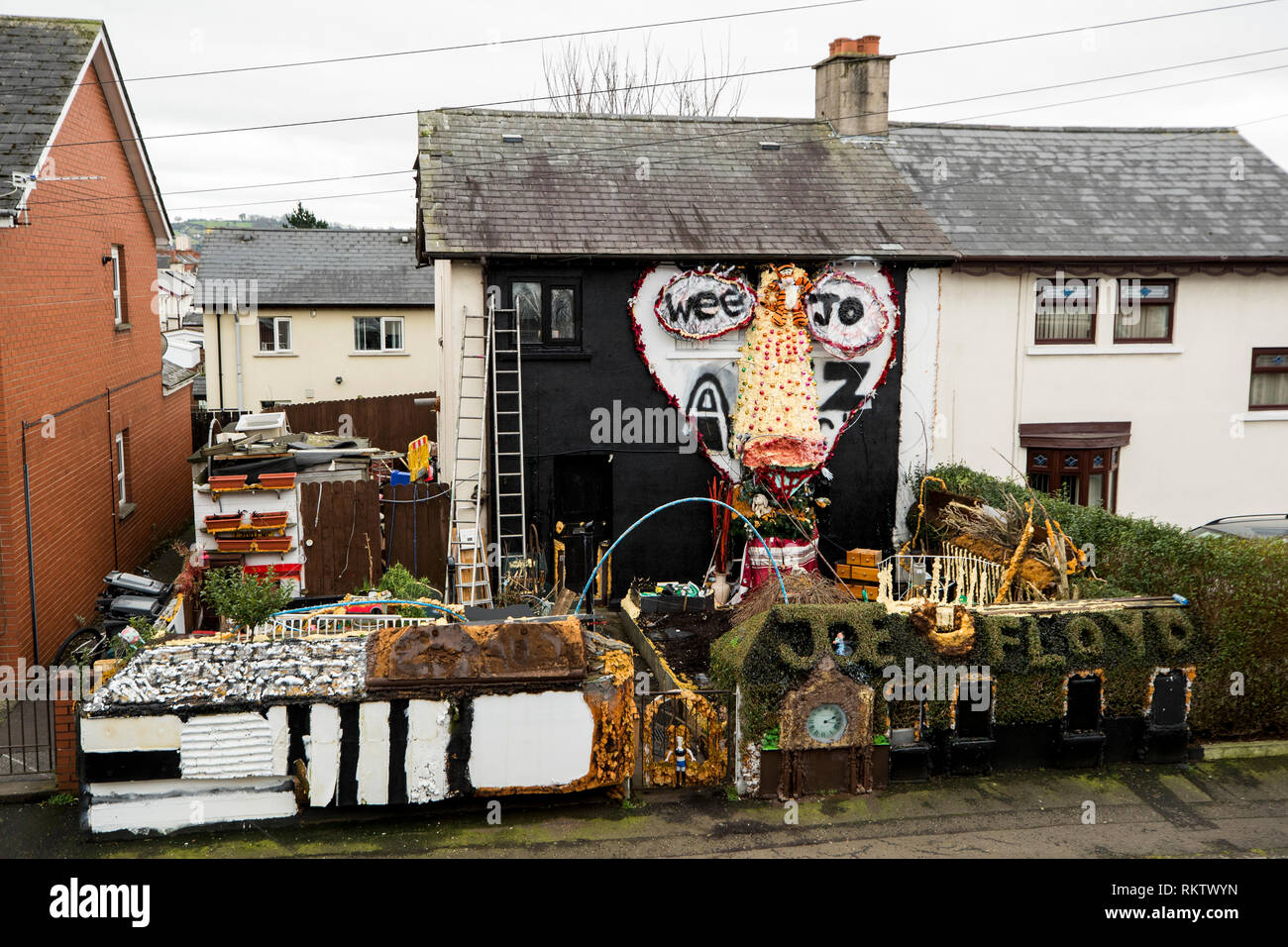 The garden of plumber joesph floyds east belfast home where recycles old furniture and things he has found to create a garden where he grows strawberries