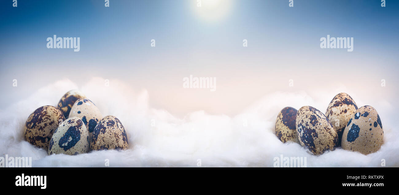 Concept image of small Easter eggs on clouds - Stock Image