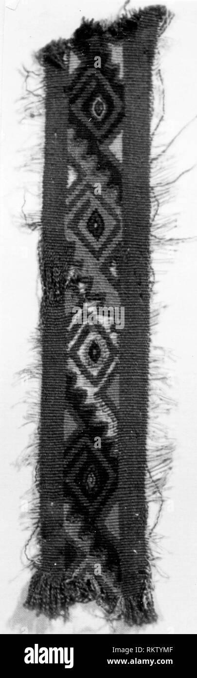 Fragment - A.D. 1000/1476 - Probably central coast, Peru - Origin: Peru, Date: 1000-1476, Medium: slit tapestry, Dimensions: 17.8 x 3.2 cm (7 x 1 1/4 - Stock Image